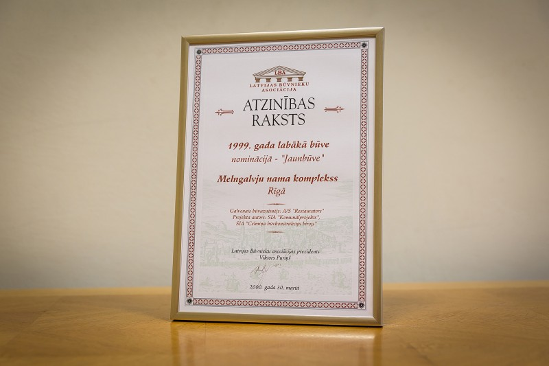 "AS ""Būvuzņēmums Restaurators"" received recognition in the competition ""Best Building 1999 [in Latvia]"" in the category ""New Building"" on 30 March 2000. This award was granted for the restored complex of House of Blackheads located in Riga, 7 Ratslaukums. It was performed in 1999."